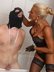Skillful Ripe Domina Tortures Her Slaves Sack Till It Gets Dark And Shiny