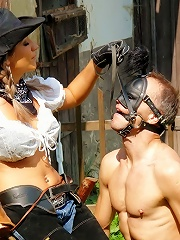 Dominatrix Babe Takes Naked Man Slave Out To Play At Horse Farm